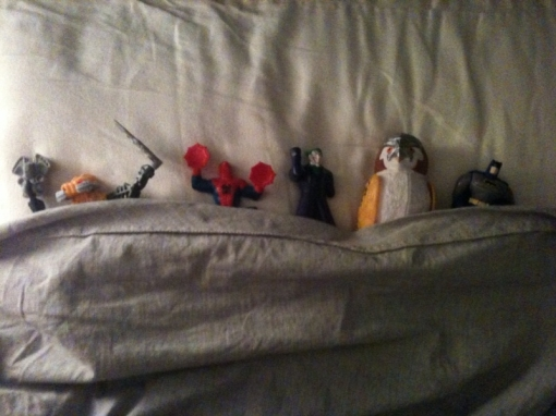 After a long day, superheroes, villains, robots and owls need their sleep.